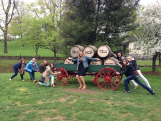 Girls trying to steal a wagon of Maker's Mark barrels!